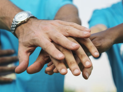 Team of volunteers stacking hands